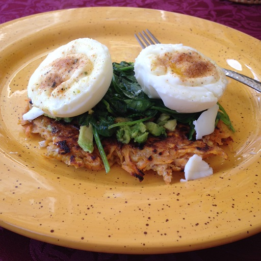 Poached Eggs over sweet potato's and sauteed spinach!