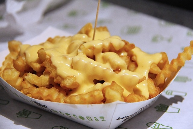 Empty Calories Can Pile on the Pounds - Tips from Healthy Diet Habits. Pictured: French Fries with Nacho Cheese Sauce