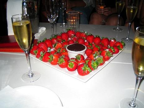 Is there a way to incorporate sweets, treats, or desserts into our lives without going hog wild? Pictured: Strawberries with Chocolate Dip and Champagne